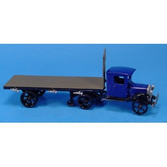 WHITE SEMI TRACTOR WITH FLAT BED TRAILER